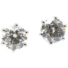 A Classic Shimansky Diamonds Studs Solitaire  Earring in 18K White Gold