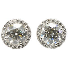 Halo Design Diamonds Studs Earrings in 18K White Gold Diamonds.