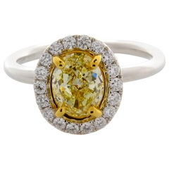 GIA Certified 1.50 Carat Oval Cut, Natural Fancy Light Yellow, SI1 Diamond Ring