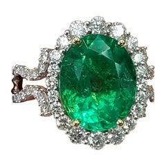 GIA Certified 18 Karat Oval Cut Emerald and Diamond Ring