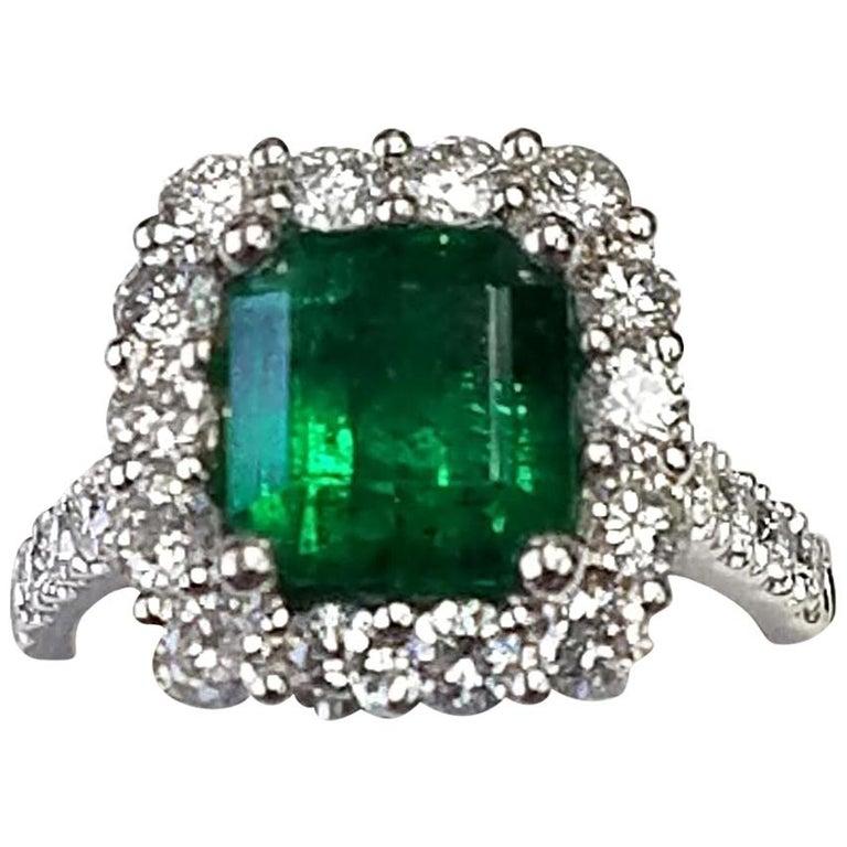 Platinum Emerald Cut Emerald and Diamond Ring For Sale