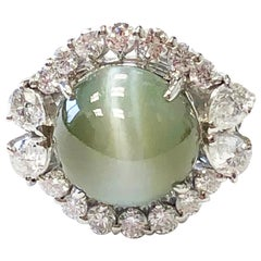 Cat's Eye Chrysoberyl Cabochon and White Diamond Round Ring in Platinum