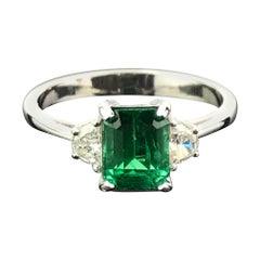 1.48 Carat Emerald and Diamond Three-Stone Engagement Ring