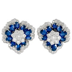 Diamond and Oval-Shaped Sapphire Flower Gold Ear Clips
