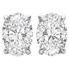 0.50 Carat Oval Brilliant Cut Diamond Stud Earrings 18 Karat White Gold Setting