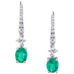 1.15 Carat Oval Emeralds with .33 Carat Diamonds 18 Karat White Gold Earrings