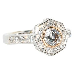 14kwg Engagement Ring - Ideal cut Octagon center diamond in a RG bezel