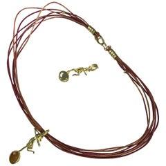 Yellow Sapphire 18K Gold Figure Pendant on Multi-Strand Leather Choker Necklace