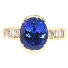 Oval Tanzanite and Diamond Baguette Ring in 14 Karat Yellow Gold