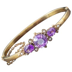 Antique Victorian Amethyst Pearl Bangle 9 Carat Gold, circa 1900
