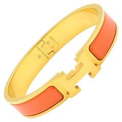 Gold Tone Hermes Orange Clic Clac Bangle Bracelet