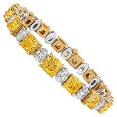 Radiant Cut Fancy Yellow Diamonds and Oval Cut Diamonds 18 Karat White Gold
