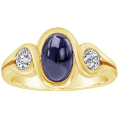 Oval Cut Cabochon Blue Sapphire and Diamond Three-Stone Ring