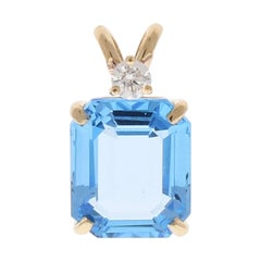 6.84 Carat Emerald Cut Swiss Blue Topaz and Diamond Pendant in 14 Karat Gold