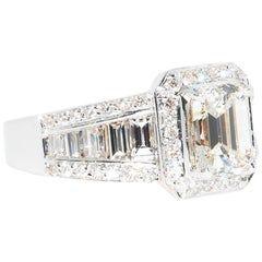 18 Karat White Gold Emerald Cut Center Engagement Ring with Baguettes and Rounds
