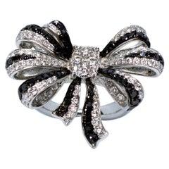 Estate Art Deco Style 18 Karat White Gold Black and White Diamond Bow Ring