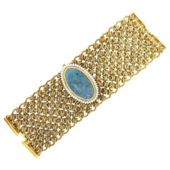 Bueche Girod 18 Karat Yellow Gold Opal Faced Diamond Watch Bracelet