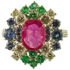 Intense Central Ruby, Diamonds, Emeralds, Blue Sapphires White Gold Cluster Ring