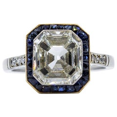 GIA Certified Platinum Emerald Cut Diamond and Sapphire Engagement Ring