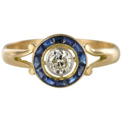 French 1920s Calibrated Sapphires Diamond Yellow Gold Ring