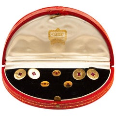 Cartier Cufflinks and Studs in 18 Karat Gold with Burma Rubies