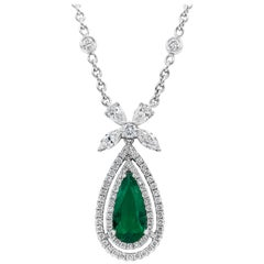 Pear Shape Colombian Emerald and Diamond Halo Pendant Necklace