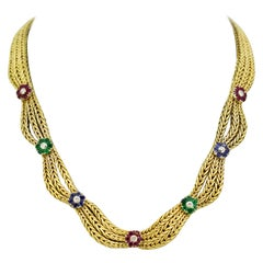 18k gold ladies necklace with natural emeralds, rubies, sapphires, and diamonds