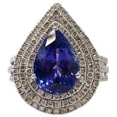 Blue Tanzanite Pear Shape and White Diamond Round Cocktail Ring in 18 Karat