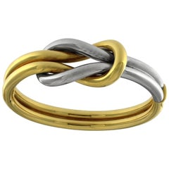 Double Knot Bangle in White and Yellow 18 Karat Gold
