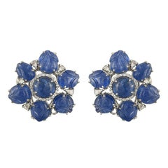 Set in 18K gold, natural Burmese Blue Sapphire carved and cabochon stud earrings
