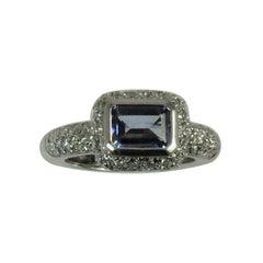 18 Karat Gold Ring Bezel Set with Emerald Cut Tanzanite and Pavé Set Diamonds