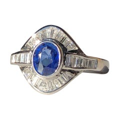 18 Karat White Gold Oval Blue Sapphire and Baguette Diamond Cocktail Ring