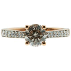 light brown/Champagne diamond single stone 0.85ct, with diamond shoulder Ring