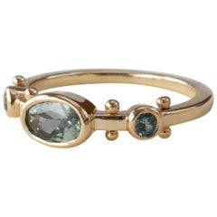 M. Hisae Oval Teal Blue Sapphire Trinity Ring