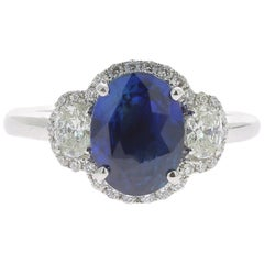 2.77 Carat Blue Sapphire Cocktail Ring Set with Oval and Round Diamond