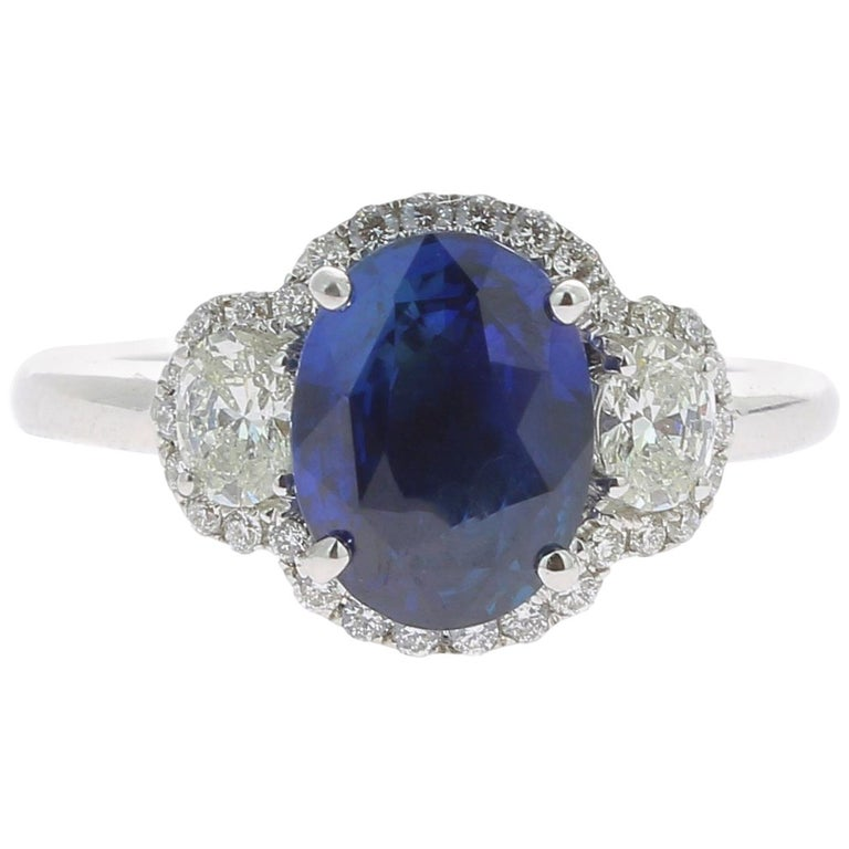 2.77 Carat Blue Sapphire Cocktail Ring Set with Oval and Round White Diamond 18K For Sale