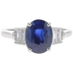 2.26 Carat Oval Intense Blue Sapphire Cocktail Ring Set Baguette White Diamond