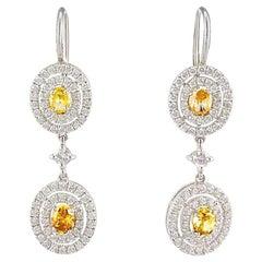 GIA Certified 1.33 Carat Total Oval Fancy Yellow Diamond Dangle Earrings