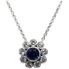 14 Karat Sapphire and Diamond Halo Pendant