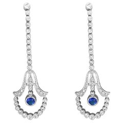 14 Karat White Gold .75 Carat Diamond and Sapphire Drop Earrings