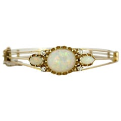 Vintage 18 Karat Yellow Gold Ladies Bangle with Natural Vivid Opal and Diamonds