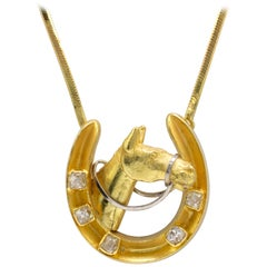 Diamond Horseshoe Pendant Necklace 18 Karat Gold with Split Chain circa 1970s