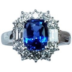 18 Karat White Gold Cushion Cut Blue Sapphire and Diamond Ring