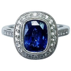 14 Karat White Gold Cushion Cut Blue Sapphire and Diamond Ring