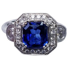 GIA Certified 18 Karat Gold Emerald Cut Blue Sapphire and Diamond Ring