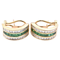 18 Karat Yellow Gold Diamond and Emerald Huggies