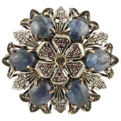 Rubies, Blue Sapphires, Diamonds 9 Karat Gold and Silver Flowery Retro Ring