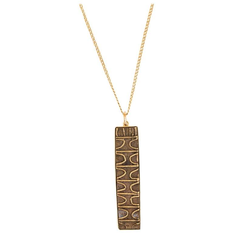 18 Karat Gold Pendant and Chain