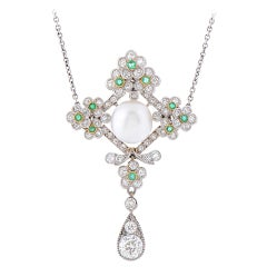 Edwardian Natural Pearl Emerald Diamond Platinum Pendant