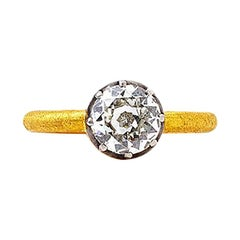 24 Karat Gold Ring with an Old European Mine Cut Diamond